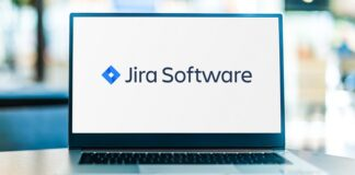 Laptop computer displaying logo of Jira