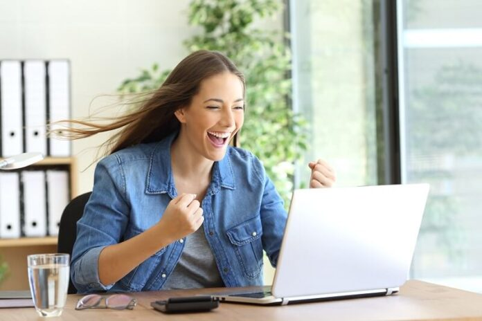 A lady using high speed internet of laptop