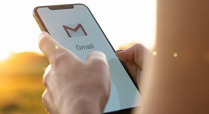 A lady using gmail on her phone